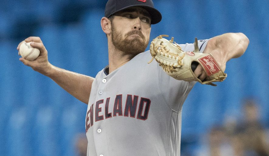 Cleveland Indians starting pitcher Shane Bieber throws to a Toronto Blue Jays batter during the first inning of a baseball game Thursday, Sept. 6, 2018, in Toronto. (Fred Thornhill/The Canadian Press via AP)