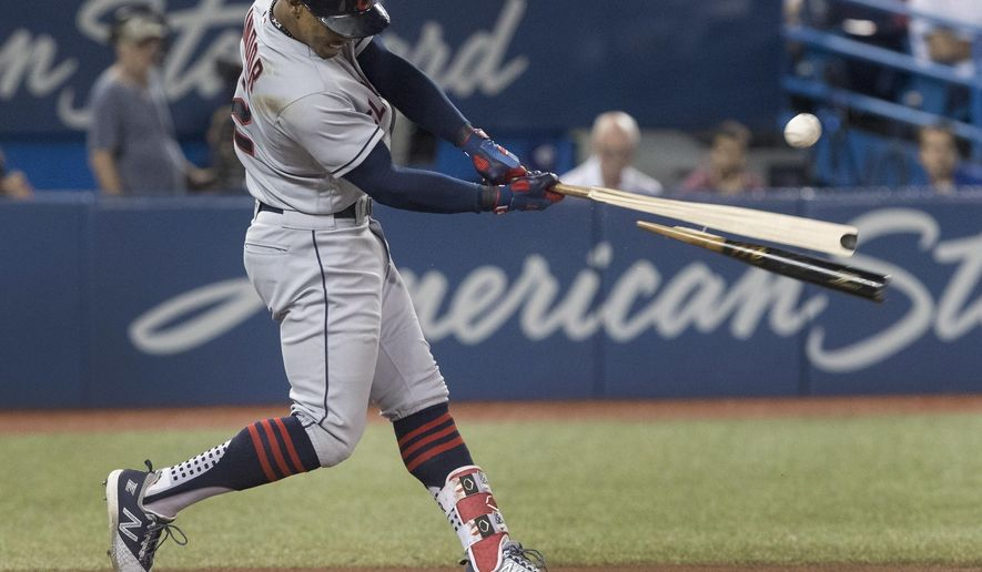 Cleveland Indians' Francisco Lindor hits a broken-bat single to drive in two runs against the Toronto Blue Jays during the fifth inning of a baseball game Thursday, Sept. 6, 2018, in Toronto. (Fred Thornhill/The Canadian Press via AP)