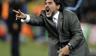 FILE - In this June 27, 2010 file photo, Argentina's head coach Diego Maradona yells from the sidelines of the World Cup round of 16 soccer match between Argentina and Mexico at Soccer City in Johannesburg, South Africa. The soccer coach of Mexico's Dorados de Sinaloa soccer team, Francisco Ramirez, was fired on Thursday, Sept. 6, 2018, and Maradona has been named the team's new coach, according to Jose Antonio Nunez. (AP Photo/Martin Meissner, File)