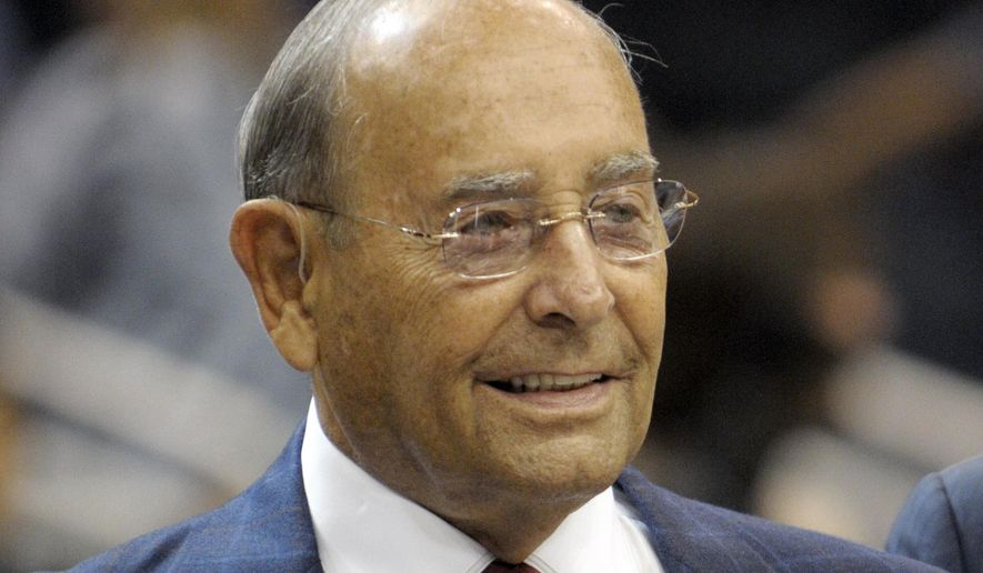 In this Oct. 10, 2010, file photo, Richard DeVos, Orlando Magic owner and Amway Inc. co-founder, smiles after welcoming fans to the new Amway Center before a preseason NBA basketball game against the New Orleans Hornets in Orlando, Fla. DeVos, the billionaire father-in-law of Education Secretary Betsy DeVos, died Thursday, Sept. 6, 2018. He was 92. (AP Photo/Phelan M. Ebenhack, File)