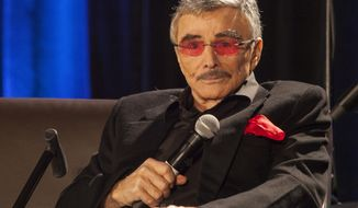 "FILE - In this Aug. 22, 2015 file photo, Burt Reynolds appears at the Wizard World Chicago Comic-Con in Chicago. Reynolds, who starred in films including ""Deliverance,"" ""Boogie Nights,"" and the ""Smokey and the Bandit"" films, died at age 82, according to his agent. (Photo by Barry Brecheisen/Invision/AP, File)"