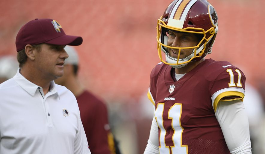 FILE - In this Aug. 16, 2018, file photo, Washington Redskins quarterback Alex Smith (11) stands next to Washington Redskins head coach Jay Gruden before a preseason NFL football game against the New York Jets, in Landover, Md. The Washington Redskins will be trying to give coach Jay Gruden his first victory in a season opener in five tries when they face the Cardinals in Arizona on Sunday. Sept. 9, 2018. The team Gruden will face is something of a mystery, with a rebuilt offense and redesigned defense under new coach Steve Wilks. (AP Photo/Nick Wass, File)