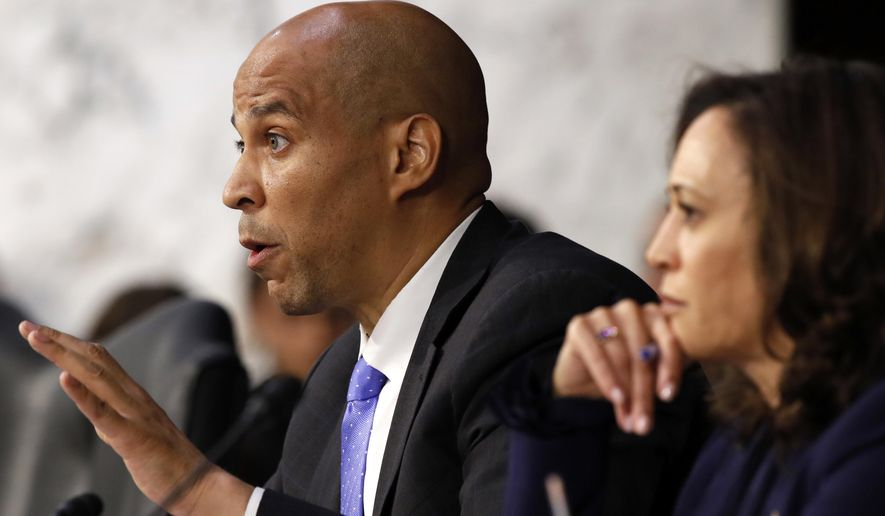 Sen. Cory Booker, D-N.J., left, next to Sen. Kamala Harris, D-Calif., questions President Donald Trump's Supreme Court nominee, Brett Kavanaugh, as he testifies before the Senate Judiciary Committee on Capitol Hill in Washington, Wednesday, Sept. 5, 2018, on the second day of his confirmation hearing to replace retired Justice Anthony Kennedy. (AP Photo/Jacquelyn Martin)