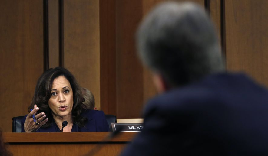 Sen. Kamala Harris, D-Calif., left, questions President Donald Trump's Supreme Court nominee, Brett Kavanaugh, in the evening of the second day of his Senate Judiciary Committee confirmation hearing, Wednesday, Sept. 5, 2018, on Capitol Hill in Washington, to replace retired Justice Anthony Kennedy. (AP Photo/Jacquelyn Martin)