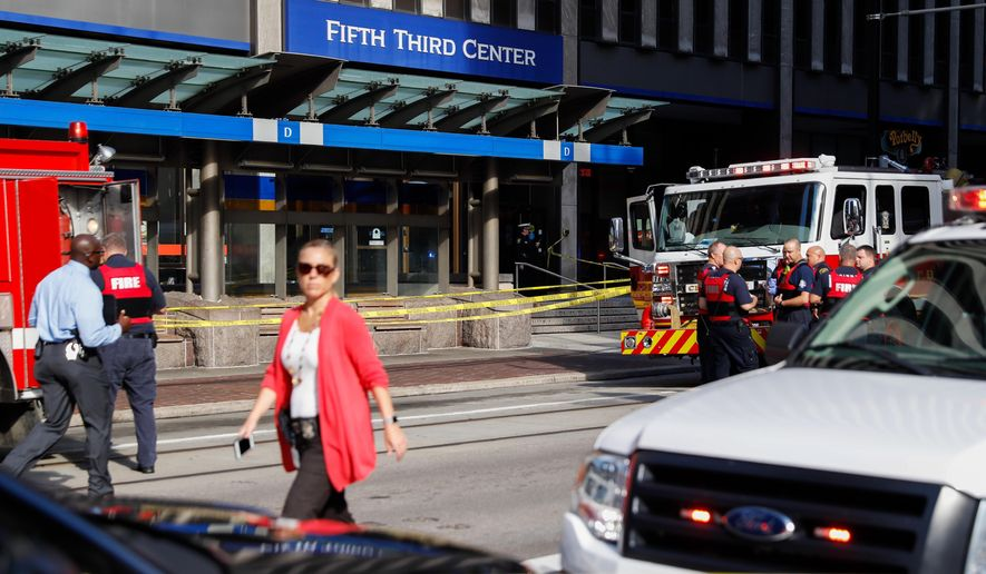 Emergency personnel and police respond to a reported active shooter situation near Fountain Square, Thursday, Sept. 6, 2018, in Cincinnati. (AP Photo/John Minchillo)
