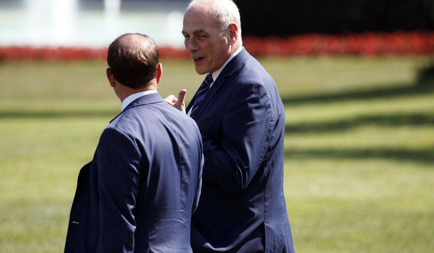 White House Chief of Staff John Kelly, right, follows President Donald Trump to board Marine One on the South Lawn of the White House, Thursday, Sept. 6, 2018, in Washington. (AP Photo/Evan Vucci)