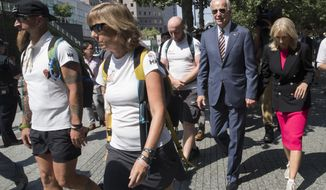 Former Vice President Joe Biden, second from right, and his wife Dr. Jill Biden, walk with members of Walking With The Wounded as they complete the 1,000-mile Walk of America, Thursday, Sept. 6, 2018, in New York. (AP Photo/Mary Altaffer)
