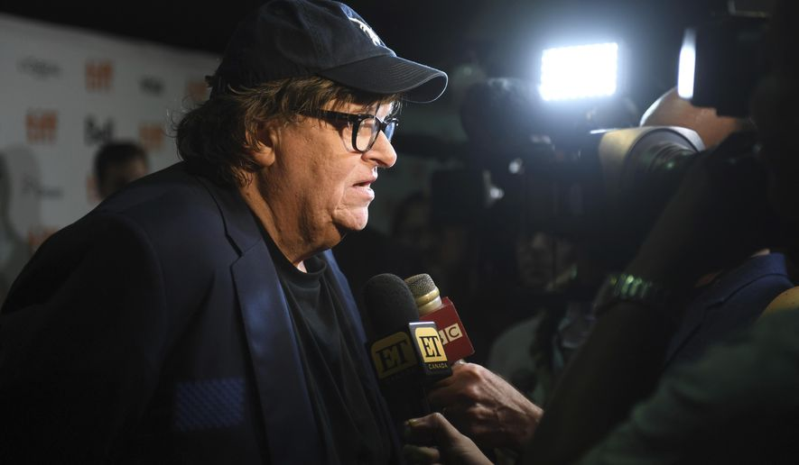 """Michael Moore speaks with journalists as he attends the premiere for """"Fahrenheit 11/9"""" on day 1 of the Toronto International Film Festival at the Ryerson Theatre on Thursday, Sept. 6, 2018, in Toronto. (Photo by Arthur Mola/Invision/AP)"""