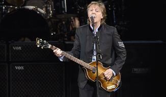 Paul McCartney performs on the One on One Tour at the Hollywood Casino Amphitheatre in Tinley Park, Ill.  (Photo by Rob Grabowski/Invision/AP, File)