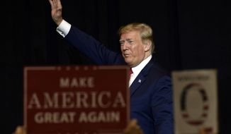 President Donald Trump walks off of the stage following a fundraiser in Sioux Falls, S.D., Friday, Sept. 7, 2018.  (AP Photo/Susan Walsh)