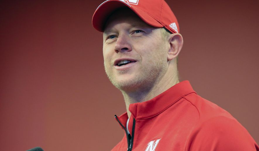FILE - In this March 14, 2018, file photo, Nebraska NCAA college football coach head Scott Frost answers questions during a news conference in Lincoln, Neb. Nebraska faces former Big 12 rival Colorado in its opener. The Cornhuskers were supposed to open against Akron last week but the game was called off because of inclement weather. Colorado comes to Lincoln off a big win over Colorado State. Colorado plays Nebraska on Saturday, Sept. 8, 2018.. (AP Photo/Nati Harnik, File)