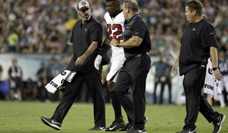 FILE - In this Sept. 6, 2018, file photo, Atlanta Falcons' Keanu Neal (22) is helped off the field after an injury during the first half of an NFL football game against the Philadelphia Eagles, in Philadelphia. Falcons safety Keanu Neal will miss the remainder of the season after hurting his left knee in Thursday night's 18-12 opening loss at Philadelphia. The loss of Neal, a leader on the defense who was selected to his first Pro Bowl in 2017, is a major blow to the Atlanta defense.(AP Photo/Matt Rourke, File)