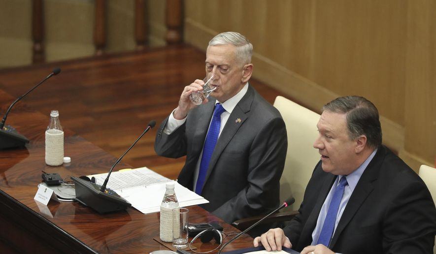 "U.S. Defense Secretary James Mattis, left, drinks water as U.S. Secretary of State Mike Pompeo, makes his statement after the so called ""2+2"" meeting in New Delhi, India, Thursday, Sept. 6, 2018. Pompeo and Mattis held long-delayed talks Thursday with top Indian officials, looking to shore up the alliance with one of Washington's top regional partners. (AP Photo/Manish Swarup) ** FILE **"