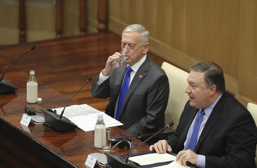 """U.S. Defense Secretary James Mattis, left, drinks water as U.S. Secretary of State Mike Pompeo, makes his statement after the so called """"2+2"""" meeting in New Delhi, India, Thursday, Sept. 6, 2018. Pompeo and Mattis held long-delayed talks Thursday with top Indian officials, looking to shore up the alliance with one of Washington's top regional partners. (AP Photo/Manish Swarup) ** FILE **"""