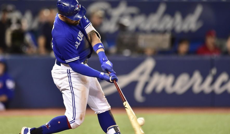 Toronto Blue Jays' Kevin Pillar hits a walk-off home run against the Cleveland Indians during the 11th inning of a baseball game Friday, Sept. 7, 2018, in Toronto. (Frank Gunn/The Canadian Press via AP)
