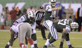 "FILE - In this Aug. 24, 2018, file photo, New York Jets quarterback Sam Darnold (14) calls an audible at the line of scrimmage during the team's NFL football game against the New York Giants in East Rutherford, N.J.  When the Jets' starting line--left tackle Kelvin Beachum, left guard James Carpenter, center Spencer Long, right guard Brian Winters and right tackle Brandon Shell-- trots onto the field in noisy Ford Field, it'll mark the first time all five will be together for a snap in a game. ""I'm very optimistic,"" offensive line coach Rick Dennison said. ""I think they've worked hard and done a good job. Obviously, it's the start of the regular season and there's a little bit of the unknown, but I feel good about the guys."" (AP Photo/Bill Kostroun, File)"