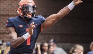 Illinois quarterback AJ Bush passes the ball from his own end zone late in the second quarter of an NCAA college football against Kent State in Champaign, Ill., Saturday, Sept. 1, 2018. (AP Photo/Holly Hart)