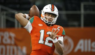 Miami quarterback Malik Rosier (12) throws during warm ups before playing LSU in an NCAA college football game Sunday, Sept. 2, 2018, in Arlington, Texas. (AP Photo/Ron Jenkins)