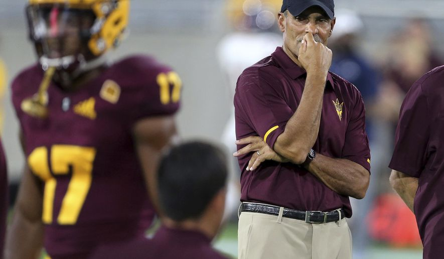 FILE - In this Sept. 1, 2018, file photo, Arizona State coach Herm Edwards watches his team warm up for an NCAA college football game against UTSA in Tempe, Ariz. Arizona State rolled over a smaller-conference school in their opener, scoring two quick touchdowns on the way to a 49-7 win over UTSA in Edwards' debut as coach. Arizona State plays Michigan State on Saturday night. (AP Photo/Ralph Freso, File)