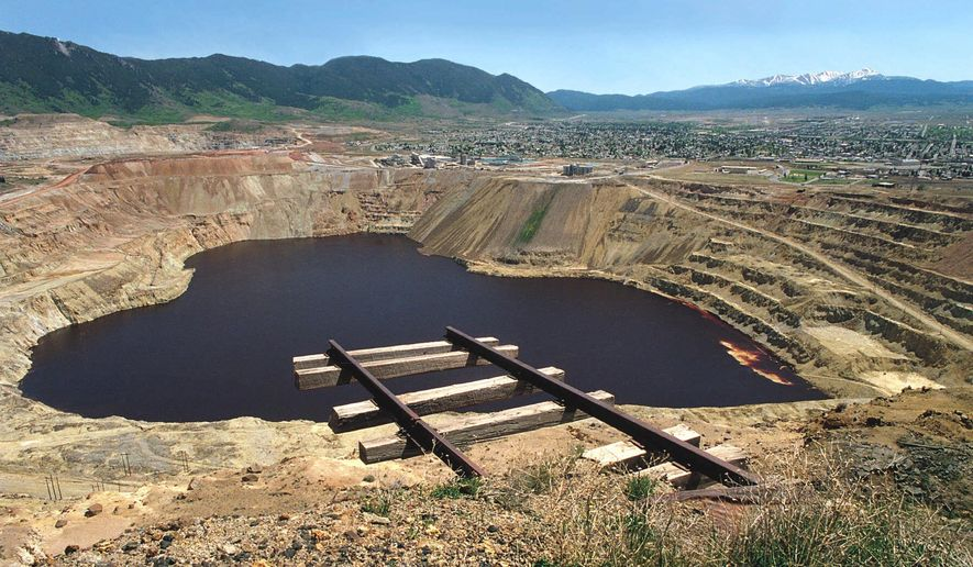 FILE - This undated photo shows the Berkeley Pit in Butte, Mont. U.S. Environmental Protection Agency Acting Administrator David Wheeler planned to visit Butte, Friday, Sept. 7, 2018, after an estimated 3,000 snow geese died when they landed in the pit in 2016. (Walter Hinick/The Montana Standard via AP)