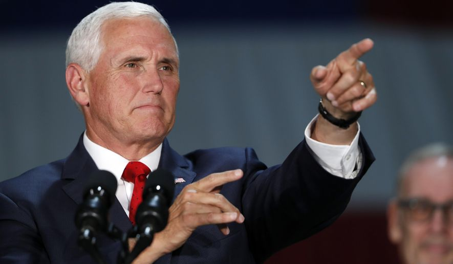 Vice President Mike Pence points to an audience member as he speaks during a visit to Nellis Air Force Base in Las Vegas, Friday, Sept. 7, 2018. (Steve Marcus/Las Vegas Sun via AP)