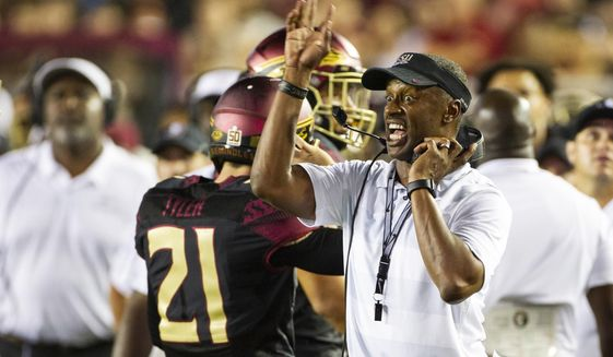 FILE - In this Sept. 3, 2018, file photo, Florida State head coach Willie Taggart directs his team in the second half against Virginia Tech in an NCAA college football game in Tallahassee, Fla. Florida State looks to build confidence in its struggling offensive line when the Seminoles take on Samford this weekend. The Seminoles struggled in their season-opening loss to Virginia Tech, allowing five sacks and after not able to establish a running game fell out of the Top 25. It was not the kind of start first-year coach Willie Taggart had hoped for. (AP Photo/Mark Wallheiser, File)