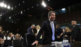 President Donald Trump's Supreme Court nominee, Brett Kavanaugh, takes his seat after a break before starting a third round of questioning on the third day of his Senate Judiciary Committee confirmation hearing, Thursday, Sept. 6, 2018, on Capitol Hill in Washington, to replace retired Justice Anthony Kennedy. (AP Photo/Jacquelyn Martin)