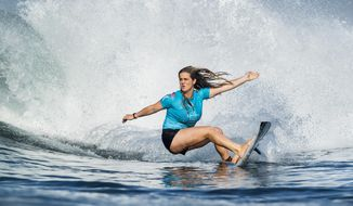 In this photo taken June 1, 2018, and provided by the World Surf League, teen sensation Caroline Marks competes in the Corona Bali Protected at Keramas, Indonesia. Marks showed her brothers, all right, who was the best surfer in the family. Goaded by her siblings at a young age while growing up in Florida, Marks took to the waves with such gusto that at 16, she's the youngest competitor on the World Surf League's Championship Tour. (Kelly Cestari/World Surf League via AP)