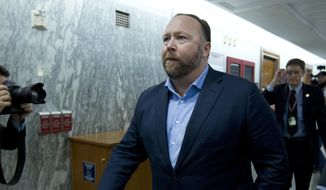 "In this Wednesday, Sept. 5, 2018, file photo, Alex Jones, the right-wing conspiracy theorist, walks the corridors of Capitol Hill after listening to Facebook COO Sheryl Sandberg and Twitter CEO Jack Dorsey testify before the Senate Intelligence Committee on ""Foreign Influence Operations and Their Use of Social Media Platforms"" on Capitol Hill in Washington. (AP Photo/Jose Luis Magana, File)"