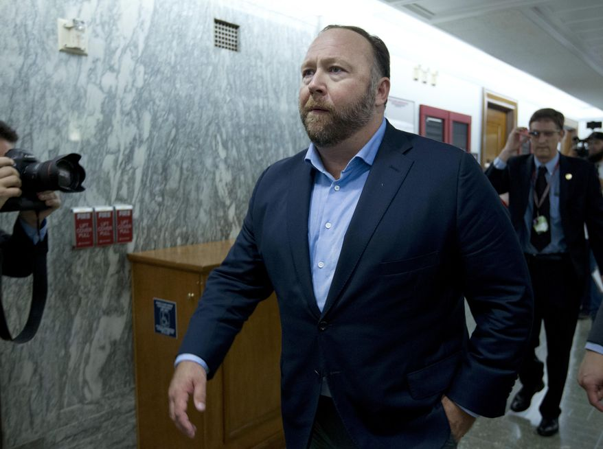 """In this Wednesday, Sept. 5, 2018, file photo, Alex Jones, the right-wing conspiracy theorist, walks the corridors of Capitol Hill after listening to Facebook COO Sheryl Sandberg and Twitter CEO Jack Dorsey testify before the Senate Intelligence Committee on """"Foreign Influence Operations and Their Use of Social Media Platforms"""" on Capitol Hill in Washington. (AP Photo/Jose Luis Magana, File)"""