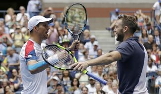Mike Bryan, left, and Jack Sock celebrate after defeating Lukasz Kubot, of Poland, and Marcelo Melo, of Brazil, in the men's doubles final of the U.S. Open tennis tournament, Friday, Sept. 7, 2018, in New York. (AP Photo/Darron Cummings)