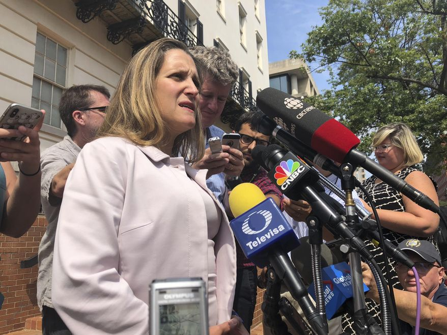 Canadian Foreign Minister Chrystia Freeland, talks to reporters outside the United States Trade Representative building in Washington, Friday Sept. 7, 2018.  (AP Photo/Luis Alonso Lugo)