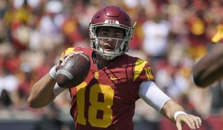 FILE - In this Sept. 1, 2018, file photo, Southern California quarterback Jt Daniels scrambles with the ball during the first half of an NCAA college football game against UNLV in Los Angeles. After getting carved up for 641 yards passing and six touchdowns by Sam Darnold last year in two losses to Southern California, Stanford coach David Shaw might be looking forward to going up against an unproven freshman quarterback for the Trojans this year. Shaw saw enough of Daniels on the recruiting trail and in film of his one college start to know the 10th-ranked Cardinal (1-0) shouldn't expect any kind of breather when they host Daniels and No. 17 USC (1-0) on Saturday night in an early season Pac-12 showdown. (AP Photo/Mark J. Terrill, File)