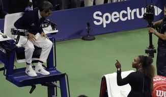 Serena Williams talks with chair umpire Carlos Ramos after being defeated by Naomi Osaka, of Japan, in the women's final of the U.S. Open tennis tournament, Saturday, Sept. 8, 2018, in New York. (AP Photo/Seth Wenig)