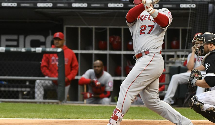 Los Angeles Angels' Mike Trout (27) hits a two run home run during the first inning of a baseball game against the Chicago White Sox on Saturday, Sept. 8, 2018, in Chicago. (AP Photo/Matt Marton)