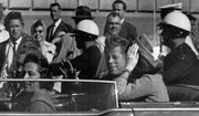 In this Nov. 22, 1963 file photo, President John F. Kennedy rides in a motorcade with his wife Jacqueline moments before he was shot and killed in Dallas. Texas Governor and Mrs. John Connally are also in the car. Video footage of Kennedy's motorcade as it drove slowly through Dallas marked an entire generation and has been the source of plenty of conspiracy theories since. (AP Photo, File)  **FILE**