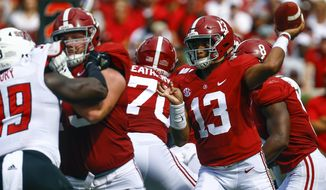 Alabama quarterback Tua Tagovailoa (13) throws a pass during the first half of an NCAA college football game against Arkansas State, Saturday, Sept. 8, 2018, in Tuscaloosa, Ala. (AP Photo/Butch Dill)