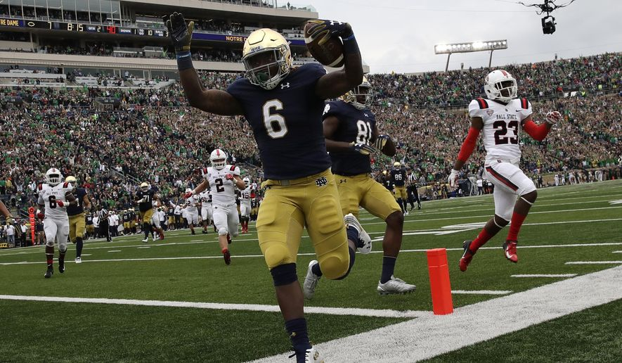 Notre Dame running back Tony Jones Jr (6) celebrates as he runs in a touchdown against Ball State during the first half of an NCAA college football game in South Bend, Ind., Saturday, Sept. 8, 2018. (AP Photo/Nam Y. Huh)