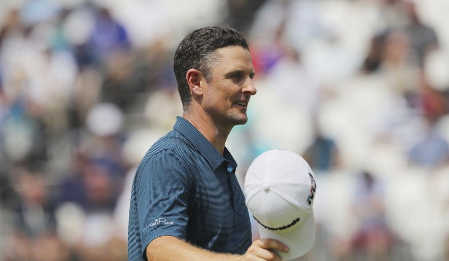 Justin Rose finishes on the 18th in the second round of the BMW Championship golf tournament at the Aronimink Golf Club in Newtown Square, Pa., Friday, Sept. 7, 2018. (David Swanson/The Philadelphia Inquirer via AP)