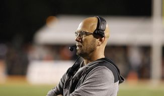 Maryland interim head coach Matt Canada watches the second half of an NCAA college football game against Bowling Green, Saturday, Sept. 8, 2018, in Bowling Green, Ohio. (J.D. Pooley/Sentinel-Tribune via AP)/Sentinel-Tribune via AP)