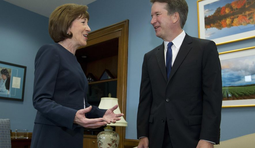 Sen. Susan Collins, Maine Republican, speaks with Supreme Court nominee Judge Brett Kavanaugh at her office, before a private meeting on Capitol Hill in Washington. The end of contentious confirmation hearings for U.S. Supreme Court nominee Kavanaugh is shifting the focus to potential swing votes like Republican Sen. Susan Collins of Maine. (AP Photo/Jose Luis Magana) **FILE**