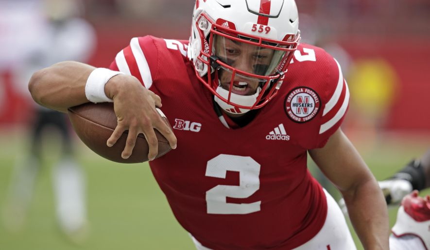 Nebraska quarterback Adrian Martinez (2) leaps for a touchdown against Colorado during the first half of an NCAA college football game in Lincoln, Neb., Saturday, Sept. 8, 2018. (AP Photo/Nati Harnik)