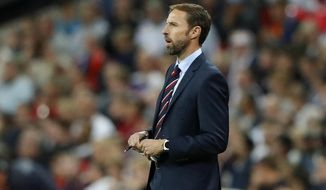 England manager Gareth Southgate stands on the touchline during the UEFA Nations League soccer match between England and Spain at Wembley stadium in London, Saturday Sept. 8, 2018. (AP Photo/Frank Augstein)