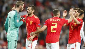 Spain goalkeeper David de Gea, Nacho Fernandez, Dani Carvajal and Sergi Roberto, from left to right, celebrate at the end of the UEFA Nations League soccer match between England and Spain at Wembley stadium in London, Saturday Sept. 8, 2018. Spain won 2-1. (AP Photo/Frank Augstein)