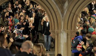 Ralph Lauren, center, greets the audience after the Ralph Lauren 50th Anniversary Fashion Show during New York Fashion Week, Friday, Sept. 7, 2018. (AP Photo/Diane Bondareff)