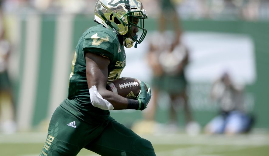 South Florida wide receiver Terrence Horne, Jr. (80) returns a kickoff for a touchdown during the first quarter of an NCAA football game against the Georgia Tech, Saturday, Sept. 8, 2018, in Tampa, Fla. (AP Photo/Jason Behnken)
