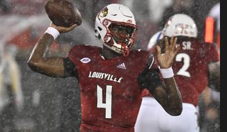 Louisville quarterback Jason Pass (4) throws a pass during the first half of the team's NCAA college football game against Indiana State, Saturday, Sept. 8, 2018, in Louisville, Ky. (AP Photo/Timothy D. Easley)