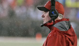 Louisville coach Bobby Petrino looks out over the field during a heavy rain in the first half of an NCAA college football game against Indiana State, Saturday, Sept. 8, 2018, in Louisville, Ky. (AP Photo/Timothy D. Easley)
