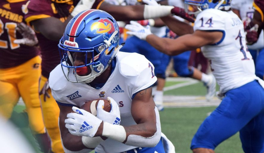 Kansas running back Pooka Williams Jr. carries the ball against Central Michigan during an NCAA college football game Saturday, Sept. 8, 2018, in Mount Pleasant, Mich. (Jim Lahde/The Morning Sun via AP)