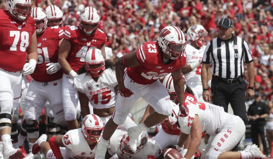 Wisconsin's Jonathan Taylor celebrates a touchdown run during the second half of an NCAA college football game against New Mexico Saturday, Sept. 8, 2018, in Madison, Wis. Wisconsin won 45-14. (AP Photo/Morry Gash)